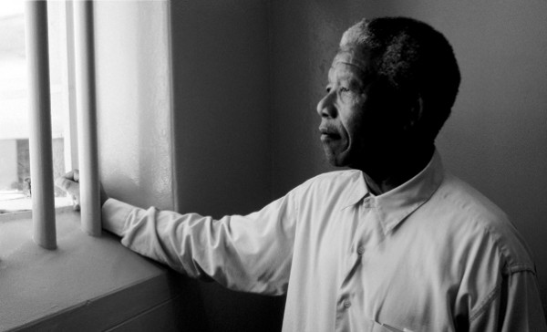 1994, South Africa --- Nelson Mandela Gazing Out Barred Window --- Image by © David Turnley/CORBIS